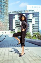 Dancing woman in the street