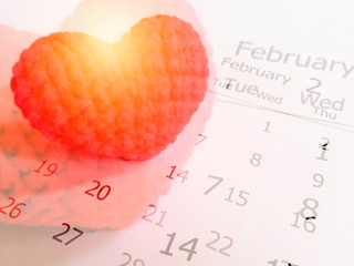 Double exposure of red heart and white calendar background for valentine's day concept.