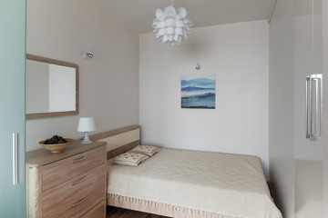 Bedroom interior in small modern apartment in scandinavian style