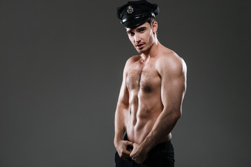 Stripper policeman wearing police hat.