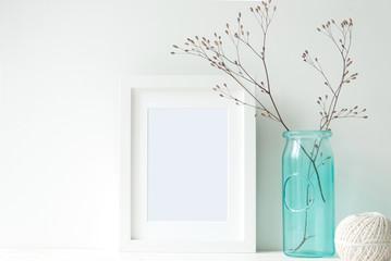 Minimal white frame with turquoise vase