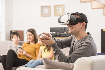 young man uses a virtual reality glasses , VR mask