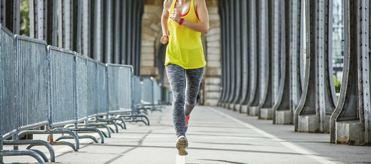 sportswoman jogging on Pont de Bir-Hakeim bridge in Paris Wall mural