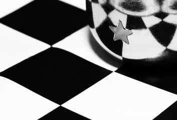 Beautiful metal cup on the chessboard