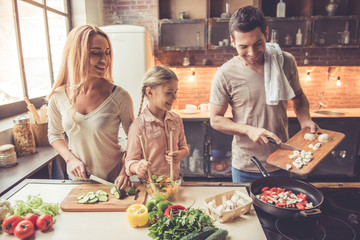 Canvas Prints Cooking Young family cooking