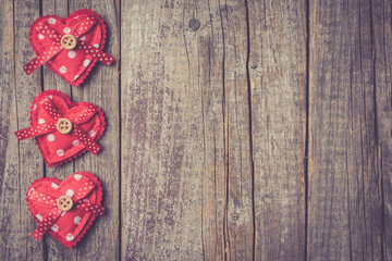 Red hearts on an old wooden table. Valentine's Day background