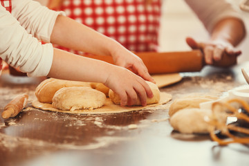 Mother and Daughter Working With Dough Together, Making Croissan