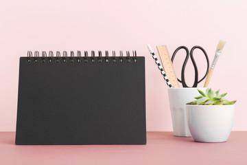 Calendar mock up on pink shelf in office