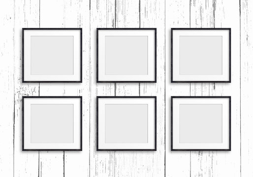 Group of six black frames on painted wooden panels background, Gallery style design mock up