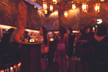 blurred background of night club interior