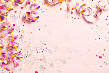 Delicate pink party background with streamers
