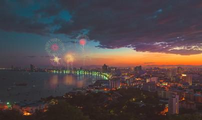 Multicolor fireworks night scene, blurred photo pattaya cityscap