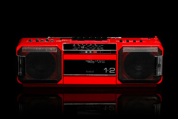 Retro red boom box on black background
