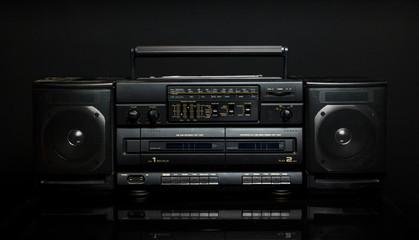 Vintage boom box on black background