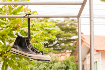 Hanging retro shoes outdoor.