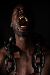 African Slave Screaming With Large Heavy Chain around His Neck.