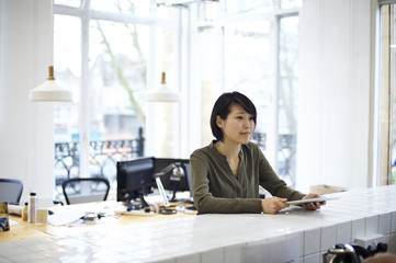 Asian businesswoman with a tablet device in an office