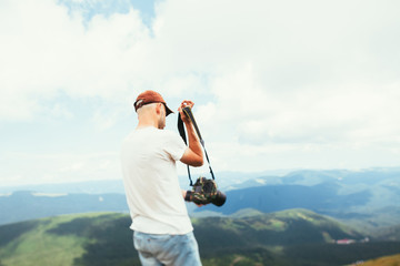 The photographer is standing in the mountains