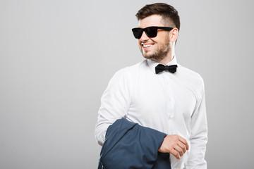 Stylish man with jacket on hand