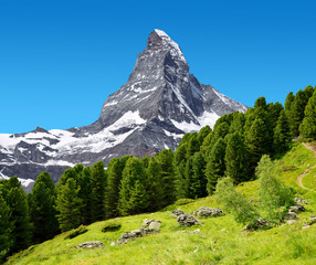 Beautiful mountain landscape with views of the Matterhorn peak in Pennine alps, Switzerland.
