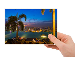 Hand and Singapore city skyline (my photo)