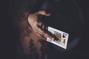 King Spade Card in Hand, Low-key lighting