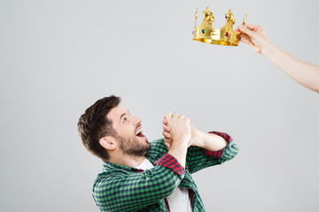 Surprised man with crown above his head