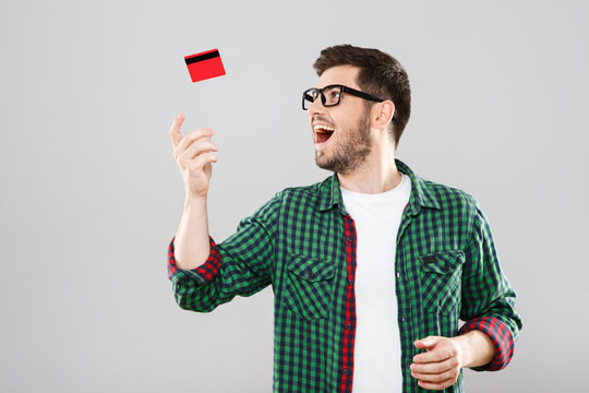 Man throwing up red credit card