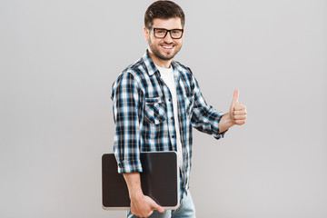 Man holding tablet and showing thumbs-up