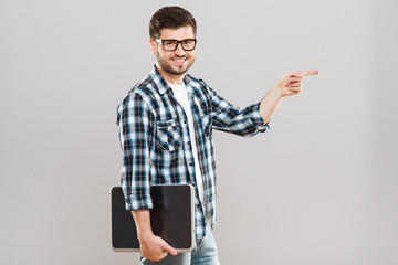 Man holding tablet and pointing aside
