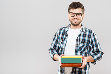 Man holding colorful books