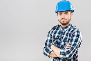 Man in blue building helmet