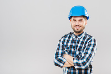 Young man in blue building helmet