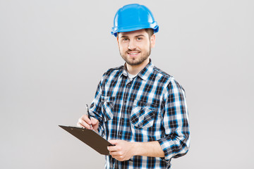 Builder writing on tablet