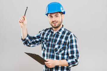 Builder holding tablet and raised pen