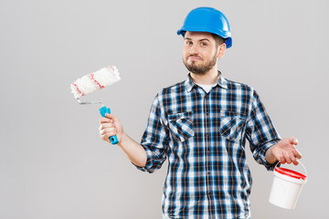 Man holding brush and paint in can