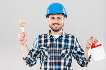 Man holding brush and can