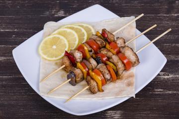 Tasty grilled meat and vegetables on skewer