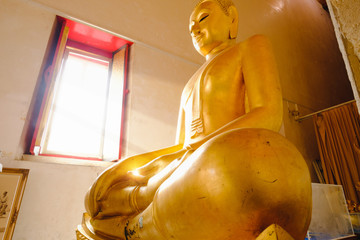 The Buddha statue near window with sunday light at Wat Pa Rerai temple in Suphanburi, Thailand.