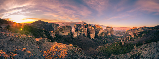 Breathtaking panoramic view of Meteora at sunset, Greece. Geological formations of big rocks with Monasteries  on top of them. Wall mural