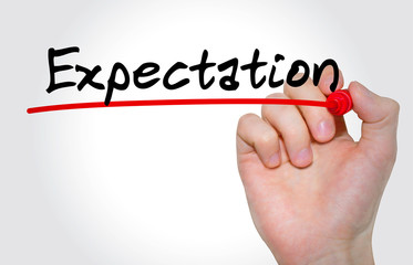"Hand writing inscription ""Expectation"" with marker, concept"
