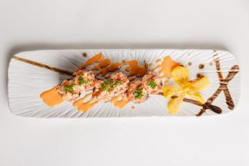 Maguro Sushi Roll Topping with Maguro(Blufin Tuna), Ebiko, Scallion and Sauce.