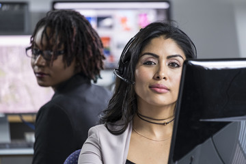 Portrait of a hispanic woman wearing a headset at work in an office