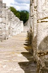 Ruins of Chitzen Itsa stone walkway of pillars with no people