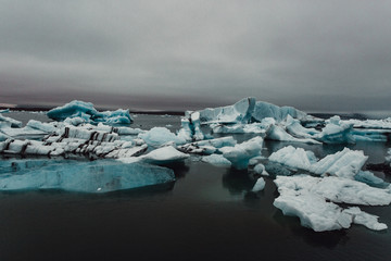 Icebergs on dark day