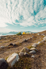 Land art and campsite by sea