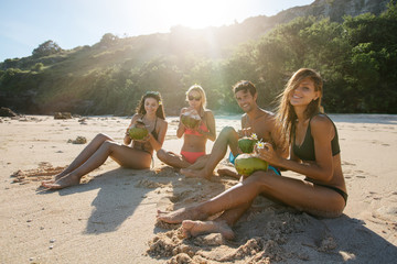Young friends enjoying summer vacation on beach