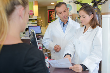 Pharmacist checking prescription