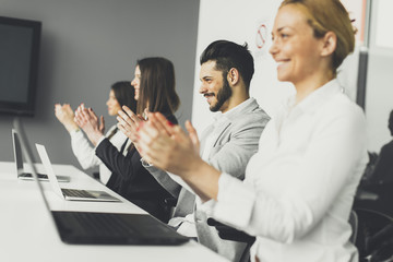 Business people applauding at conference
