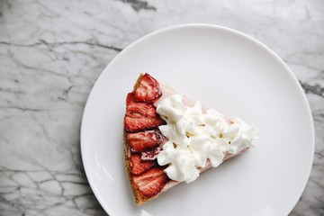Portion of strawberries and cream pie